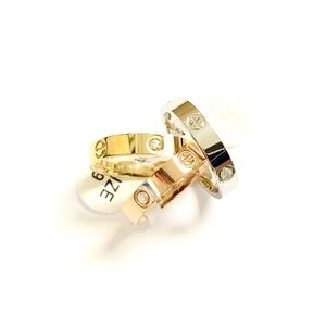 Jewelry - STAINLESS STEEL LOVE CZs SCREW HEAD BAND RING